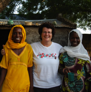 Ginny Carroll and two African women